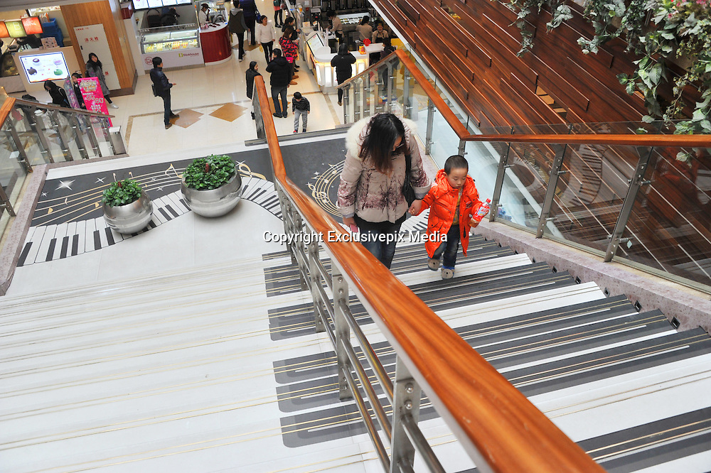 SHANGHAI, CHINA - FEBRUARY 16: (CHINA OUT)<br /> <br /> Piano Stairs<br /> <br /> Customers walk on stairs made like keys of a piano at a shopping mall on February 16, 2016 in Shanghai, China. The piano stairs are constituted by 34 steps and they will produce musical sounds of the different notes when walking on. <br /> &copy;Exclusivepix Media