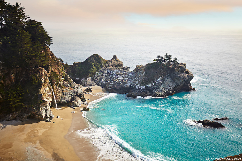 A view of a waterfall and the Pacific Ocean from Julia Pfeiffer Burns State Park, Big Sur, California.