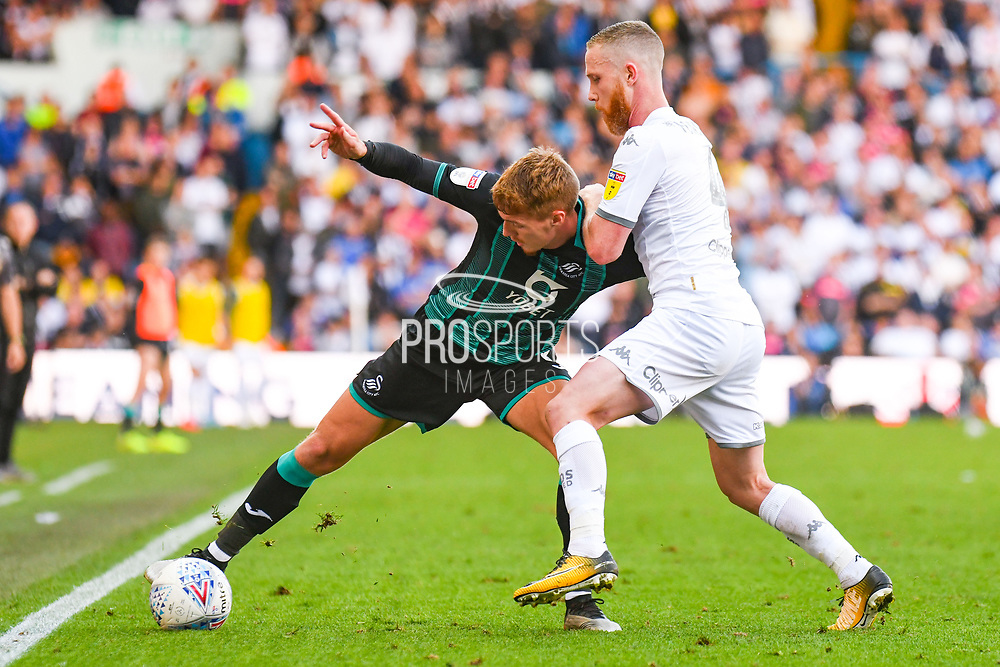 Swansea City midfielder Jay Fulton (6) and Leeds United midfielder Adam Forshaw (4) during the EFL Sky Bet Championship match between Leeds United and Swansea City at Elland Road, Leeds, England on 31 August 2019.