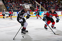 KELOWNA, BC - DECEMBER 18: Jake Lee #21 of the Kelowna Rockets checks Alex Kannok Leipert #41 of the Vancouver Giants as he skates with the puck into the offensive zone during first period at Prospera Place on December 18, 2019 in Kelowna, Canada. (Photo by Marissa Baecker/Shoot the Breeze)