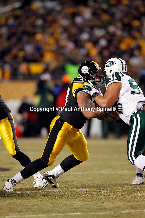 Pittsburgh Steelers center Maurkice Pouncey (53) blocks New York Jets defensive tackle Sione Pouha (91) during the NFL 2011 AFC Championship playoff football game against the New York Jets on Sunday, January 23, 2011 in Pittsburgh, Pennsylvania. The Steelers won the game 24-19. (©Paul Anthony Spinelli)
