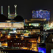 "Kansas City's Crossroads District area with buildings lit Royal Blue for Kansas City Royals 2014 World Series run. Kauffman Center, Convention Center ""Skystation"" pylons, Downtown Marriott Hotel, side of Union Station."