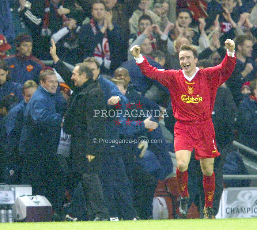 LIVERPOOL, ENGLAND - Tuesday, March 19, 2002: Liverpool's manager Gerard Houllier and Vladimir Smicer celebrate their side's 2-0 victory over AS Roma during the UEFA Champions League Group B match at Anfield. (Pic by David Rawcliffe/Propaganda)