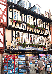 Architecture and facade in Quimper, featuring the town's famous Breton Faience pottery.  Building houses the Art de Cornouaille, known for its selection of the city's famous hand-paainted pottery.