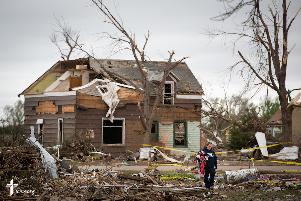 Residents sift through debris in a neighborhood on Monday, May 11, 2015, in Delmont, S.D. A tornado swept through the area the previous day and destroyed Zion Lutheran Church and nearby buildings. LCMS Communications/Erik M. Lunsford