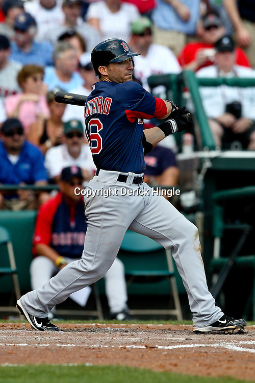 March 16, 2011; Lake Buena Vista, FL, USA; Boston Red Sox shortstop Marco Scutaro (16) during a spring training exhibition game against the Atlanta Braves at the Disney Wide World of Sports complex.  Mandatory Credit: Derick E. Hingle