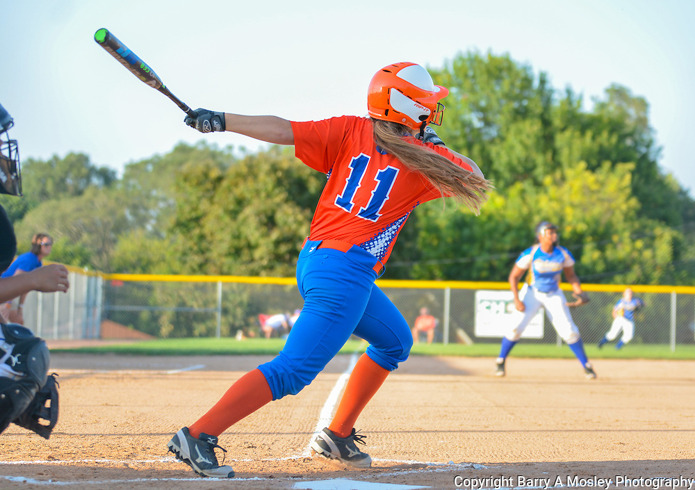 Omaha Gross High School Softball player at full swing, photo by Barry A Mosley Photography of Lincoln, Nebraska.