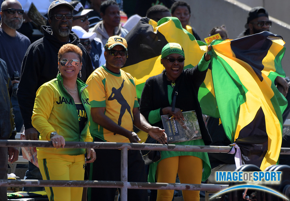 Apr 28, 2018; Philadelphia, PA, USA; Jamaican fans wave flags during the 124th Penn Relays at Franklin Field.