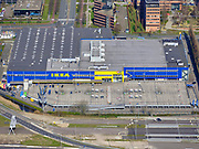 Nederland, Noord-Holland, Amsterdam; 23-03-2020; Bullewijk, Woonwarenhuis IKEA met leeg parkeerterrein ten gevolge van de Corona crisis.<br /> Het publieke leven in het centrum van de hoofdstad is bijna geheel stil komen te liggen als gevolg van het Corona virus. Niet alleen is alle horeca dicht, ook veel winkels en andere bedrijven zijn gesloten. Het publiek blijft over het algemeen binnen, de straten en pleinen zijn verlaten.<br /> Amsterdam, Ikea housing department store with empty parking lot..<br /> Public life in the center of the capital has come to a complete standstill as a result of the Corona virus. Not only are all pubs, coffee shops and restaurants,  closed, many shops and other companies are also closed. The public generally stays inside, the streets and squares are very quiet.<br /> <br /> <br /> luchtfoto (toeslag op standaard tarieven);<br /> aerial photo (additional fee required)<br /> copyright © 2020 foto/photo Siebe Swart
