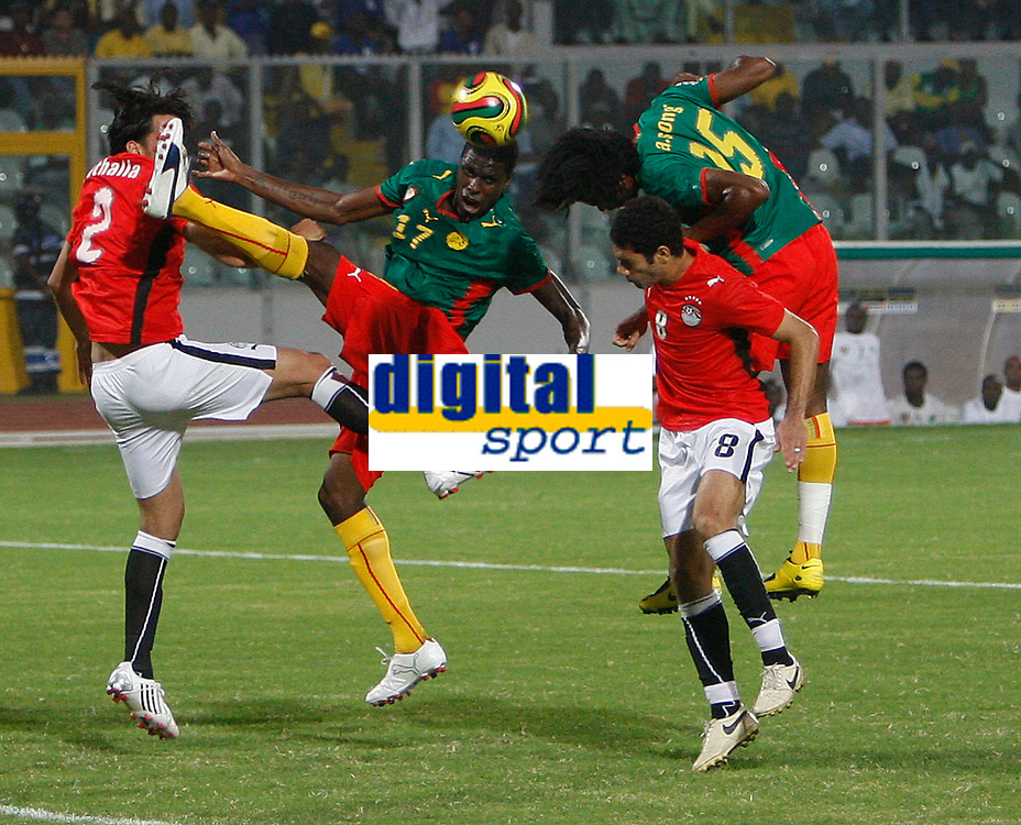 Photo: Steve Bond/Richard Lane Photography.<br /> Egypt v Cameroun. Africa Cup of Nations. 22/01/2008. Goal mouth pressure as Mahmoud Fathalla (L) defends in front of Mohamadou Idrissou (CL) raised boot.