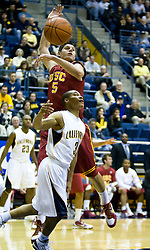 January 9, 2010; Berkeley, CA, USA;  Southern California Trojans forward Nikola Vucevic (5) reaches for a rebound from California Golden Bears guard Jerome Randle (3) during the first half at the Haas Pavilion.  California defeated USC 67-59.