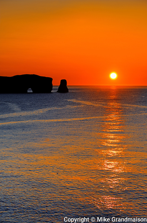 Rocher percé (Percé Rock)  at sunrise and the Atlantic Ocean<br /> Percé <br /> Quebec<br /> Canada