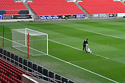 General view inside Ashton Gate Stadium with the groundsman painting the white lines before the The FA Cup 5th round match between Bristol City and Wolverhampton Wanderers at Ashton Gate, Bristol, England on 17 February 2019.