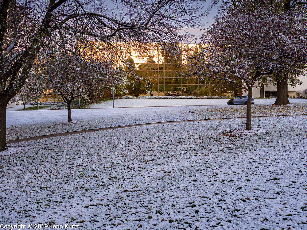29 OCTOBER 2019 - DES MOINES, IOWA: A dusting of snow on the grounds of the Iowa State Capitol with the state capitol reflected in the Henry Wallace Building, an Iowa state office building in the background. An unseasonably early dusting of snow, less than 1 inch, blanketed the Des Moines area Tuesday morning. The snow did not accumulate on roads or sidewalks and did not impact the morning commute. Des Moines normally gets its first accumulation of snow in mid-November. More snow is expected later this week.              PHOTO BY JACK KURTZ