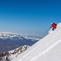 """Skier on the decent of the """"Super Gully"""" on Lost River Peak 12078 ft"""