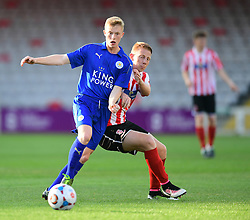 Lincoln City's Reece Robinson-Jones vies for possession with Leicester City's Morgan Brown<br /> <br /> Lincoln City under 18s Vs Leicester City under 18s at Sincil Bank, Lincoln.<br /> <br /> Picture: Chris Vaughan/Chris Vaughan Photography<br /> <br /> Date: July 28, 2016
