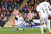 Dan Holman scores and celebrates his first goal during the Vanarama National League match between Cheltenham Town and FC Halifax Town at Whaddon Road, Cheltenham, England on 16 April 2016. Photo by Antony Thompson.