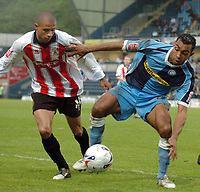 Photo: Leigh Quinnell.<br /> Wycombe Wanderers v Cheltenham Town. Coca Cola League 2, Play off Semi Final. 13/05/2006. Wycombes Kevin Betsy keeps Cheltenhams Gavin Caines at arms length.