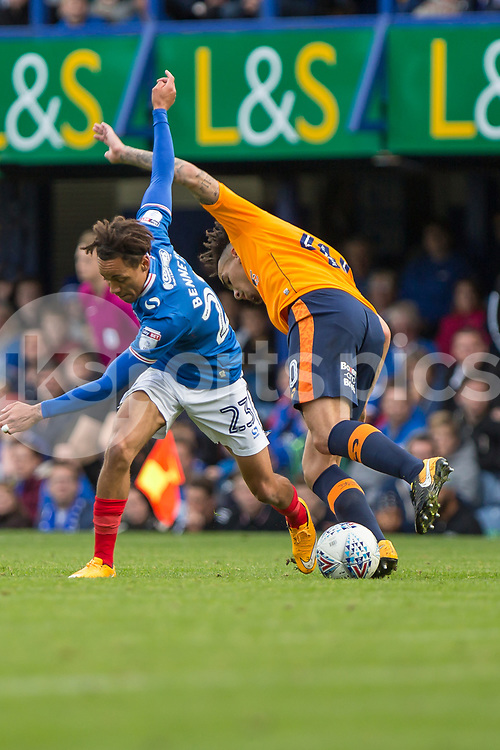Kyle Bennett of Portsmouth  and Kean Bryan of Oldham Athletic during the EFL Sky Bet League 1 match between Portsmouth and Oldham Athletic at Fratton Park, Portsmouth, England on 30 September 2017. Photo by Simon Carlton.