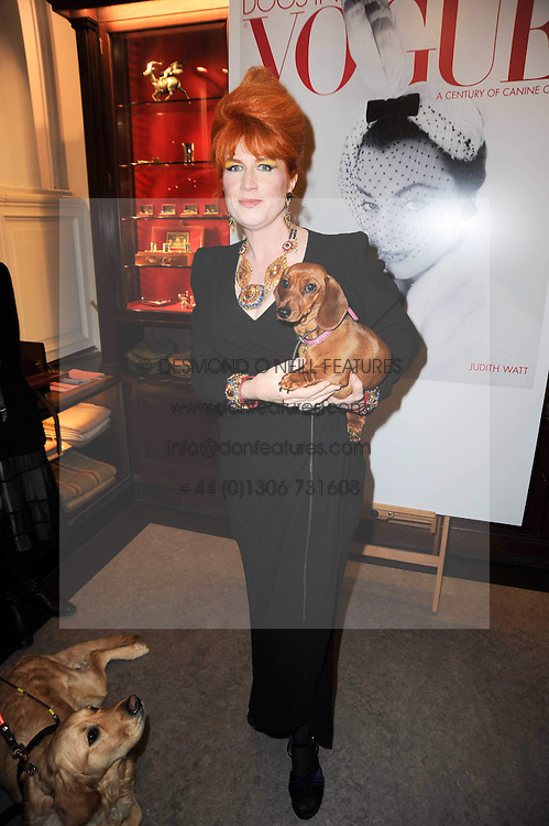 JUDITH WATT and dog Wiggles at a party to celebrate the publication of Dogs in Vogue by Judith Watt held at James Purdey & Sons, Audley House, 57-58 South Audley Street, London W1 on 3rd December 2009.