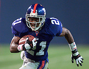 New York Giants' Tiki Barber charges towards the end zone.