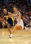 Oct. 29 2010; Phoenix, AZ, USA; Phoenix Suns point guard Steve Nash (13) handles the ball against Los Angeles Lakers point guard Derek Fisher (2) during the first quarter at the US Airways Center. Mandatory Credit: Jennifer Stewart-US PRESSWIRE.