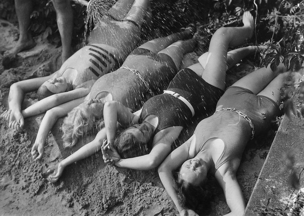 Four Women with Hose Spraying on Them, Gleinkersee near Steyr, Austria, circa 1933