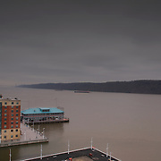 Southern view from top floor of near completed Hudson Park Tower North. Looking down Hudson River towards George Washington Bridge with cliffs of Palisades at right and Yonkers Pier in foreground.