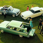Studebaker's 1963 model lineup showing the Wagonaire, Lark, and Gran Turimso Hawk.