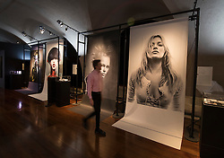 © Licensed to London News Pictures. 01/11/2016. London, UK. Photographs of models, including Kate Moss (R) highlight the work of hair stylist Sam McKnight at the 'Hair by Sam McKnight' exhibition at Somerset House. The show, which runs from 2nd November, 2016 to 12th March, 2017, celebrates the career of fashion's favourite hair stylist. Photo credit: Peter Macdiarmid/LNP