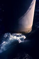 Stock photo of water churning around a pillar