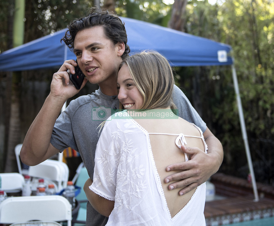 June 12, 2017 - Huntington Beach, CA, USA - Huntington Beach High School baseball player Nick Pratto gets a hug from his girlfriend Chance Burden during the MLB Draft Day at Burden's House in Huntington Beach on Monday, June 12, 2017. (Credit Image: © Kyusung Gong Kyusung Gong/The Orange County Register via ZUMA Wire)