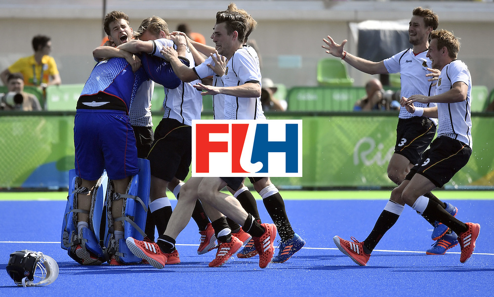 Germany's players celebrate after winning the men's Bronze medal field hockey Netherlands vs Germany match of the Rio 2016 Olympics Games at the Olympic Hockey Centre in Rio de Janeiro on August 18, 2016. / AFP / PHILIPPE LOPEZ        (Photo credit should read PHILIPPE LOPEZ/AFP/Getty Images)
