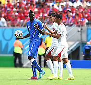 Mario Balotelli of Italy and Michael Umana of Costa Rica during the 2014 FIFA World Cup match at Itaipava Arena Pernambuco, Recife metropolitan area<br /> Picture by Stefano Gnech/Focus Images Ltd +39 333 1641678<br /> 20/06/2014