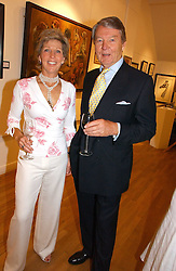 TOMMY & GINA SOPWITH at an exhibition of art by Sam Sopwith held at 27 Cork Street, London W1 on 23rd May 2006.<br /><br />NON EXCLUSIVE - WORLD RIGHTS