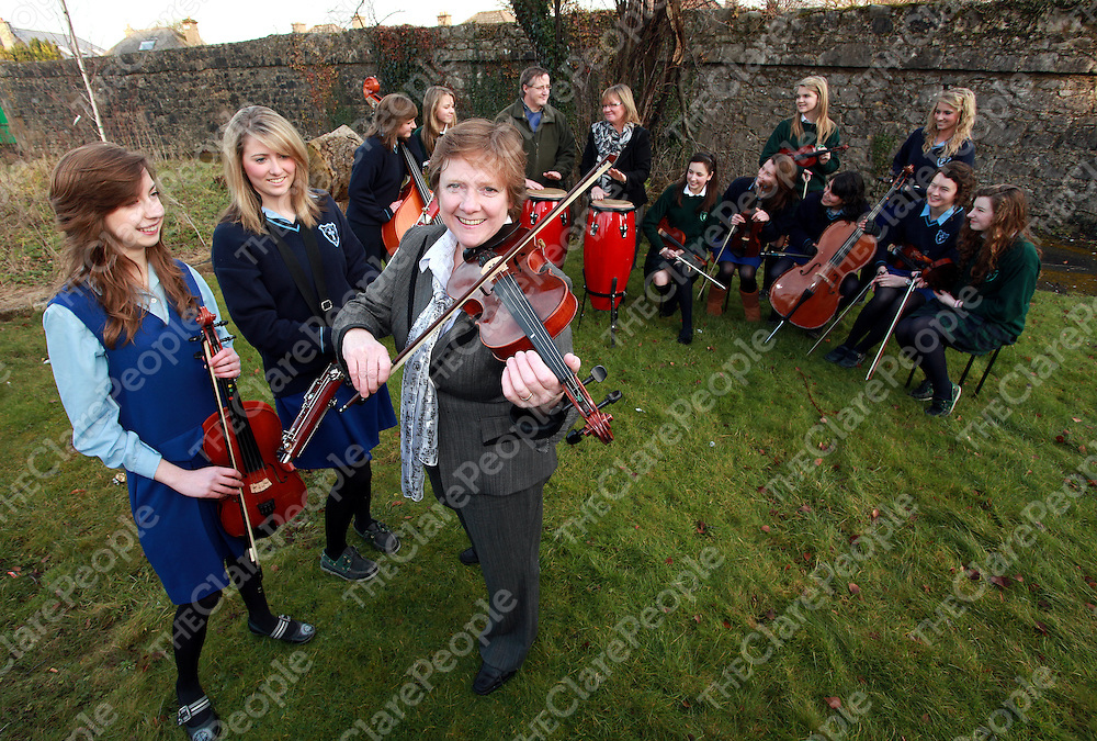 Grainne Murphy and Tara Darcy along with other members of the Colaiste Muire orchestra were joined by music teacher Cathy Desmond, head of music Michael Hennessy and principal Jean Pound as the group get ready to take part in the Irish Association of Youth Orchestra Festival in the National Concert Hall on February 13th.<br /> Photograph by Yvonne Vaughan