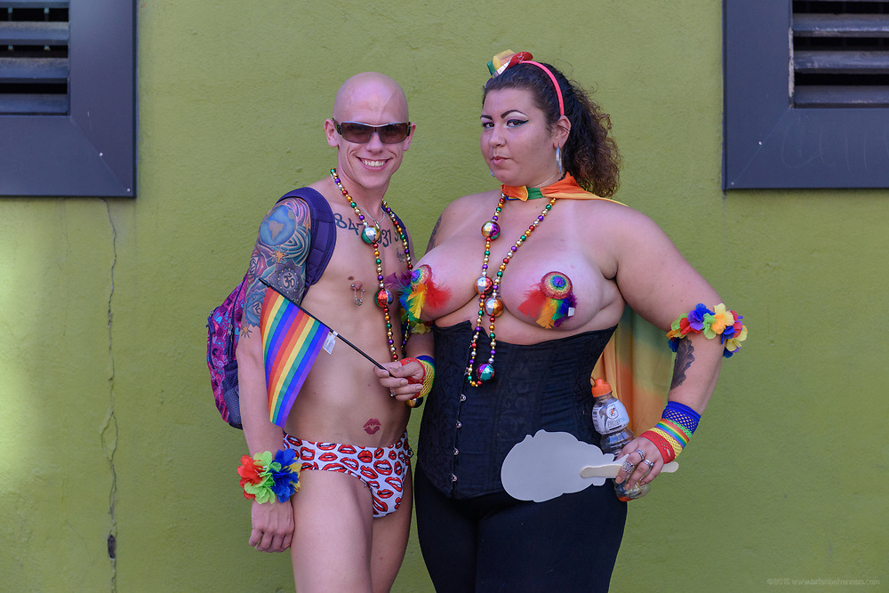 Dan Flaherty and Nikki Devereaux pose for a photo in front of The Connection before the parade.<br /> The Lesbian, Gay, Bisexual, Transgender, and Queer (LGBTQ) community and their friends, family and supporters walked and lined Main Street from Floyd Street to the Belvedere for the Kentuckiana Pride Parade, Saturday, June 16, 2017 in Louisville, Ky. (Photo by Brian Bohannon)
