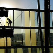 Shane Tumlinson of Architectural Wall Systems worked on attaching a section of a glass panel covering the new Sprint Center in downtown Kansas City, Mo. on Wednesday, February 28, 2007.