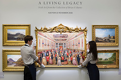 "© Licensed to London News Pictures. 16/11/2018. LONDON, UK. Technicians present ""St. Patrick's Hall, Dublin Castle"", by F.J. Davis (Est. GBP200,000-300,000). Preview of ""A Living Legacy"", the Irish Art Collection of Brian P. Burns, a collection spanning artists from the 18th century to the present day.  Over 100 works will be offered for sale on 21 November at Sotheby's in London.  Photo credit: Stephen Chung/LNP"