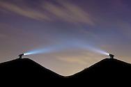 DEU, Germany, Ruhr area, Gelsenkirchen, the heap Rungenberg, two laser spots on the heap illuminates the sky by night, light installation Nachtzeichen.<br /> <br /> DEU, Deutschland, Ruhrgebiet, Gelsenkirchen, Bergehalde Rungenberg, zwei Laserkanonen auf der Halde, die nachts den Himmel erleuchten, Lichtinstallation Nachtzeichen.