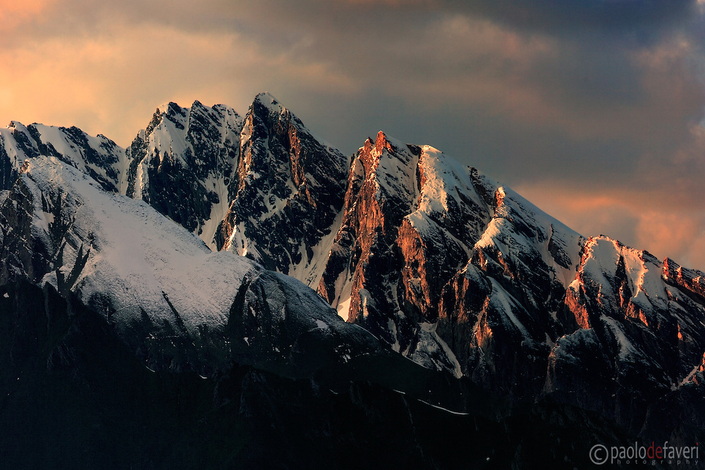 A beautiful moountain ridge shining in the warm light at sunset. Taken in the Western Alps nearby Morgex in Valle d'Aosta, Italy, this is stitched from five vertical takes.
