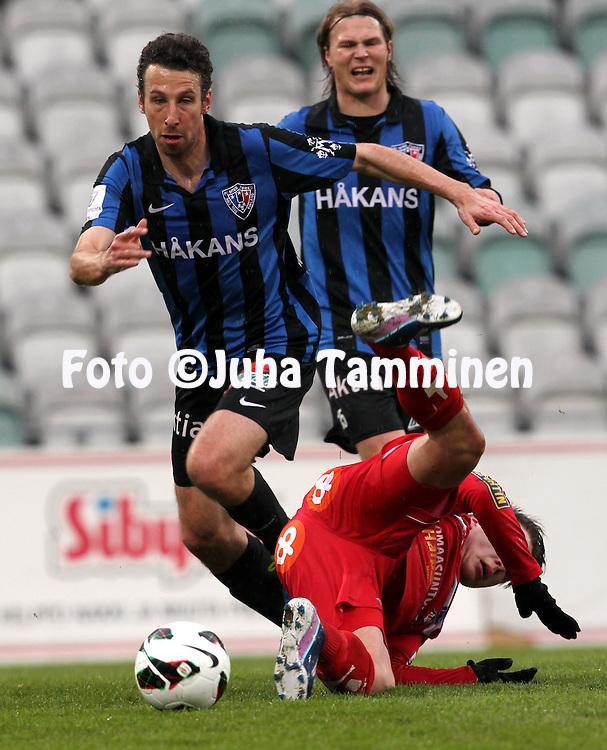 29.4.2013, Veritas Stadion, Kupittaa, Turku..Veikkausliiga 2013..FC Inter Turku - FF Jaro..Tamas Gruborovics (Inter) v Simon Skrabb (Jaro) , taustalla Severi Paajanen..
