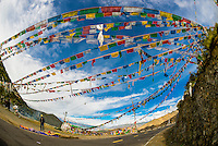 Prayer flags over road, Chatang, Tibet (Xizang), China.