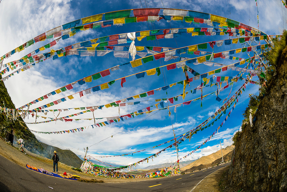 Prayer flags over road, Chatang, Tibet (Xizang), China.