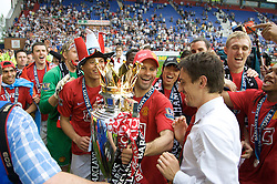 WIGAN, ENGLAND - Sunday, May 11, 2008: Manchester United's Ryan Giggs hands over the trophy to Gary Neville as they celebrate winning the Premier League after the final Premiership match of the season at the JJB Stadium. (Photo by David Rawcliffe/Propaganda)