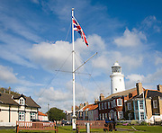 Union Jack flag lighthouse and houses at Southwold, Suffolk, England