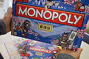 A customer looks at the special edition Aizu version of Monopoly at the Aizuwakamatsu Tourism Produce Association in Aizu-wakamatsu City, Fukushima Prefecture, Japan on 01 May 2013.  Photographer: Rob Gilhooly