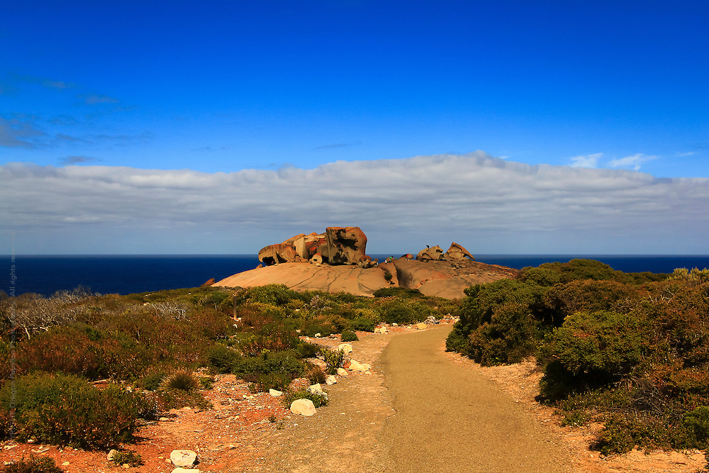 landscape photography: iconic natural landscape Remarkable Rocks, Kangaroo Island, South Australia with view down approaching road to the ocean
