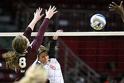 02 November 2012:  Brooklyn Hlafka powers a hit past defender Olivia Brand during an NCAA womens volleyball match between the Missouri State Bears and the Illinois State Redbirds at Redbird Arena in Normal IL