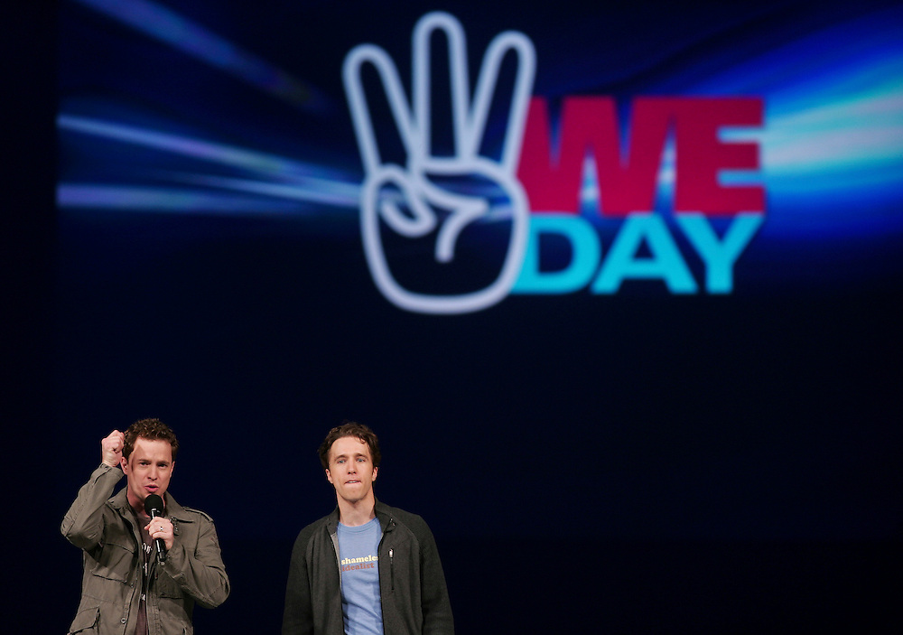 Marc, left, and Craig Kielburger, co- founders of the charity Free the Children speak at the charity's We Day celebrations in Kitchener, Ontario, February 17, 2011. We Day was started to celebrate the power of young people. <br /> The Canadian Press/GEOFF ROBINS